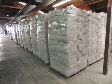 many pallets of attic blow-in cellulose insulation in the warehouse